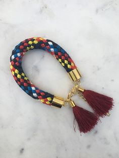 One-of-a-kind tassel bracelets available at Uppermoda. Perfect for summer!
