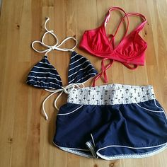 Nautical Bikini bundle 2 string bikini tops  The first is navy and white striped with a tie around the neck and the back (not padded) this one has no tags any longer no brand on it The second is red with an underwire (not padded) and has a criss cross back tie this one is from Popina  Both tops will fit up to a small or 36B cup  The bottoms are from target and are navy with nautical anchor detailing and are a size Medium but can fit a small popina Swim Bikinis
