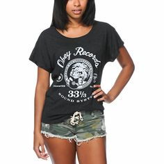 """Rock out in style thanks to the Obey Conquer Babylon dolman tee shirt for girls. Coming in a Solid Black colorway, this relaxed fit tee shirt is built with a lightweight and comfortable tri-blend construction, a wide crew neck collar and short dolman sleeves. Printed at the front there is an """"Obey Records"""" lion graphic in White for added style. Paring perfectly with jeans and a zip up hoodie, the Conquer Babylon dolman tee shirt will make an excellent choice."""