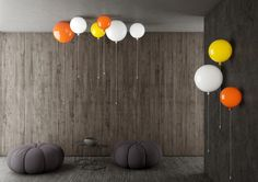 Interior - Brokis lights - White, yellow and orange balloons Memory are hanging lights. Design by Boris Klimek.
