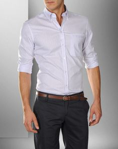 What I see when Ana says He's standing there in his dress pants and white linen shirt!!!!!!