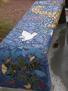 Blue mosaic outdoor bench. How to get the glass pieces smooth at the edges on the curves?