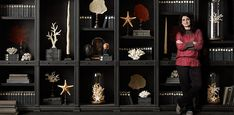 The Reproductionist | Restoration Hardware - look at the tall glass cloche, with the white coral on a stand...