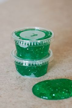 Create your own magical monster slime using Elmer's Clear School Glue, Borax, food coloring, and glitter! Perfect for #Halloween parties.