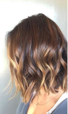 An effortless fade from a shiny, brunette shade to a subtle lift with caramel highlights. This is the perfect way to do ombre on short hair. Color by Katherine Hyde.