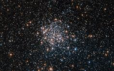 This NASA/ESA Hubble Space Telescope image shows the star cluster NGC 1854, a gathering of red, white and blue stars in the southern constellation of Dorado (The Dolphinfish). NGC 1854 is located about 135,000 light-years away in the Large Magellanic Cloud (LMC), one of our closest cosmic neighbors and a satellite galaxy of the Milky Way.