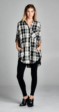 Welcome to your new favourite tunic. Just like a comfy plaid shirt except for.....wait for it.....pockets! Long enough for leggings and classic in black and white. Oversized tunic Plaid Pockets on the side Gathered detail on back Front upper pocket Rounded hem Made in USA Silver Icing Exclusive $54.99