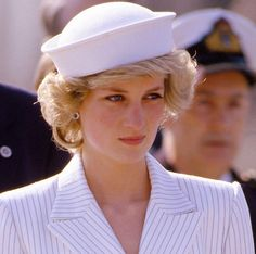Princes Charles & Princess Diana arrive at the naval base at La Spezia, Italy on April 20, 1985 during the Royal Tour of Italy. Diana wore a dress by Catherine Walker with a hat by Kangol.