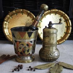 Vintage brass mortar and pestle, Turkish herbs (pepper or salt) grinder or hand mill. Vintage and antique brass ware.