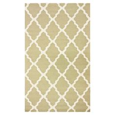 Wool rug with a Moroccan trellis motif. Hand-hooked in India.  Product: RugConstruction Material: 100% Wool...