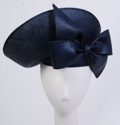Boldly designed, sculpted shiny navy blue straw hat (front view) | Designer: Jack McConnell | United States, 1980's