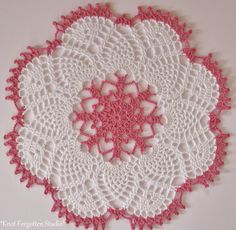 Stash busting~ Little Doilies Finished December, 2014. The pattern is from Magic Crochet Gifts. I used Aunt Lydia's thread, size 3. The colors are Warm Rose and White.