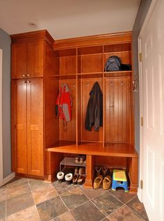 Do you have a picture of this mud room with the cabinet doors open? Also what does the opposite wall have on