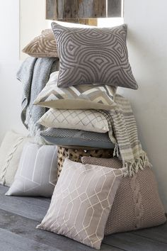 Stack of unique neutral and muted color Surya pillows in a variety of pattern, style, color and texture!