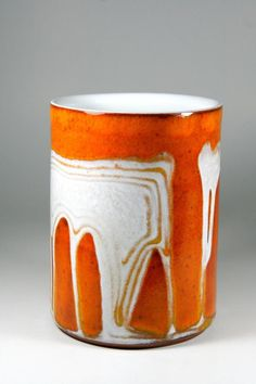 Imagine that you brew the perfect cup of sanity-saving warmth in this gorgeous coffee mug, glazed in drippy white and orange, made from terracotta. Get yours now , you`ll thank us later ! #coffeemugs #pottery #kitchenware #handmadepottery