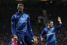 Arsenal striker Danny Welbeck celebrates after scoring against former club Man United at O...