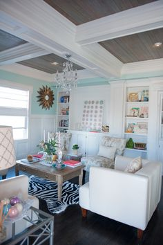 House of Turquoise: Guehne-Made Living Room-salvaged the original 100 year-old wood floors, sanded and stained each piece, then added them as an inset in the coffered ceiling