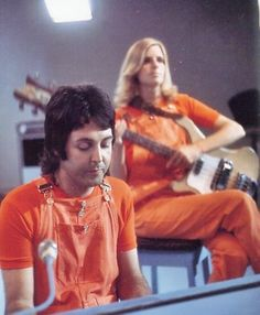 Orange jumpsuits? Where are they, in prison??? This really IS the band on the run!!! XP