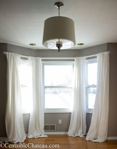 Bay windows can be expensive and difficult to decorate. Learn how to easily make this simple, gorgeous bay window curtain rod without spending a fortune.How # window decor Diy Bay Window Curtains, Bay Window Bedroom, Bay Window Curtain Poles, Bay Window Decor, Bay Window Living Room, Window Curtain Rods, My Living Room, Burlap Curtains, Window Seats