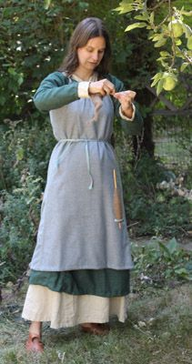 Brynja's Viking outfit ( inspiration for Aelfwyn's garb. Madder dyed dress, sunbleached undertunic, greenish wool overdress/hangeroc,tablet woven belt)