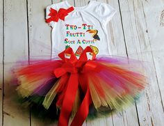 This Birthday Tutu set is an adorable 2nd Birthday tutu girl Birthday outfit that is accented with a rainbow outfit featuring Two-tti fruity pary shirt. The custom tutu outfit Perfect for a two year old birthday. This outfit comes with a 3 layered tutu, shirt and a headband.