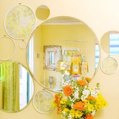 Circular Sensation      Kick up your walls with curvy circles. Arrange circular pieces on a wall, starting with the object you want to be in the middle. From there, build out your arrangement, ensuring that each piece touches an adjacent piece. This wall art installment features a mix of round mirrors and painted embroidery hoops, some of which have fabric stretched inside of them.