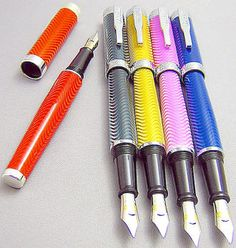 Herringbone Fountain Pens  -- What do y'all think of these? Kinda cool colors, especially that red!