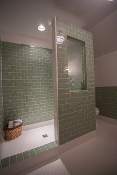 Vintage green and white tile.  Textured glass for the shower window.