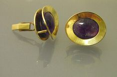 """Large, beautifully designed, gold cufflinks with amethysts by Art Smith; each is about 1-1/8"""" x 7/8""""; constructed in two layers so the amethyst cabochons float in between; has typical Art Smith patination on parts of the gold; findings are marked """"14K"""" and cufflinks are marked """"Art Smith"""" (in script); cufflinks come from a private New York collection of a couple who purchased these and other pieces directly from Smith"""