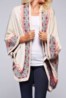 Just in! Oversized border print cardigan. No front closure.  Style tip: Wear now with jeans and flats for a fun casual look. As the weather warms up bring to the beach to throw on over a bathing suit as the weather cools down in the evenings.