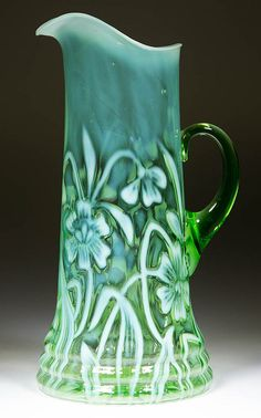 "DAFFODIL TANKARD WATER PITCHER, green opalescent, applied handle. H Northwood Co. Circa 1903. 12 1/8"" HOA. / SOLD $1,495"