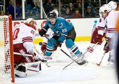 San Jose Sharks forward Tye McGinn crashes the net for a rebound (Nov. 22, 2014).