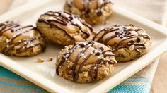 Chocolate lovers won't be able to resist these caramel-topped cookies drizzled with melted chocolate.