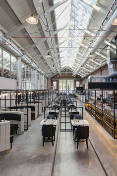 Framework Studio, designed the interior of Meat West, a restaurant located inside De Hallen, a former tram repair depot in Amsterdam.