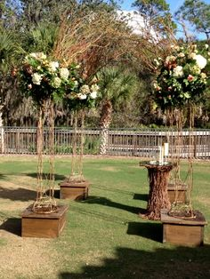 Ceremony arbor setup of rustic garden party whimsy of browns, green and ivory