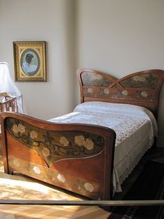 Wood Art Nouveau bed with painted flowers