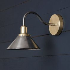 This Gooseneck Metal Shade Wall Sconce fixture features Mixed Metals -Raw Brass Mount -Raw Steel Gooseneck pipe -Raw Brass Socket RAW Steel Cone Shade / 220 Volt Watts Max -UL Listed -Un Over Sink Lighting, Garage Lighting, Wall Sconce Lighting, Kitchen Wall Lighting, Rustic Wall Lighting, Bedside Wall Lights, Exterior Lighting, Outdoor Lighting, Rustic Wall Sconces