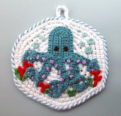 Google Image Result for http://fc00.deviantart.net/fs70/i/2011/112/b/4/crochet_octopus_pot_holder_by_meekssandygirl-d3els3s.jpg