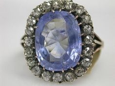 Victorian Sapphire Ring. 18 karat yellow gold Victorian ring. One cushion cut sapphire (6.95 carats). Twenty old European cut diamonds (0.77 carats: SI-I clarity: J-K colour).   Please make an appointment to see this item