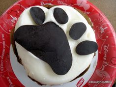 Disney snack credit use: Paw Print Brownie from the Kusafiri Bakery in the Animal Kingdom. This brownie nearly fills this 8 inch plate! It is a rich brownie base, covered in chocolate ganache, covered in vanilla buttercream, topped with a cute chocolate paw print. This one is definitely one to share.