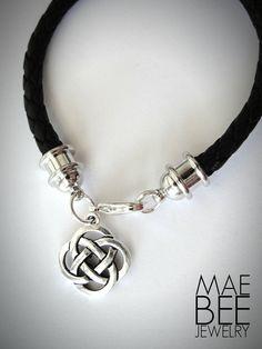 Celtic Knot on black braided leather bracelet from JewelryByMaeBee on #Etsy. #sfetsy www.jewelrybymaebee.etsy.com