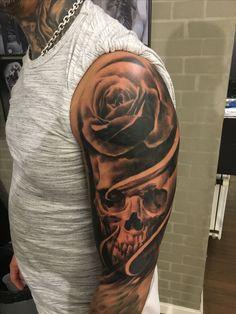 Skull rose tattoo overarm sleeve