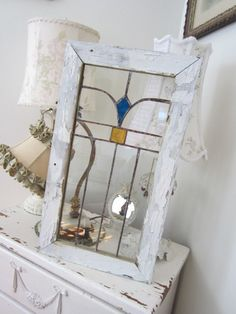 Like the idea of putting an old stain glass window or any old window and hanging it up they're so beautiful