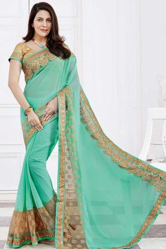 Sky-Blue, chiffon saree with cream silk blouse.  Embellished with embroidered, zari and stone.  Saree comes with round neck blouse.  http://www.andaazfashion.com/womens/sarees/fabric/chiffon-saree