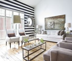 Living room by designer Ty Larkins with a striped black and white wall and light knotty pine floors. Checkt out the blog today http://cococozy.com to see this room's floor plan from a birds eye view!