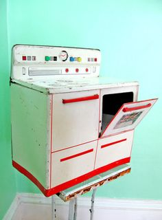 Toy tin stove. From Megan Jeffery's blog, Beetlegrass.