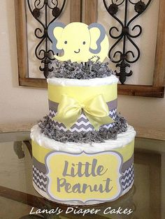 PLEASE READ STORE ANNOUNCEMENT BEFORE PLACING AN ORDER: https://www.etsy.com/shop/LanasDiaperCakeShop?ref=hdr_shop_menu 2 Tier Yellow And Gray Elephant Diaper Cake Would make a wonderful gift for new baby or stunning centerpiece for a baby shower. Something any Mother would