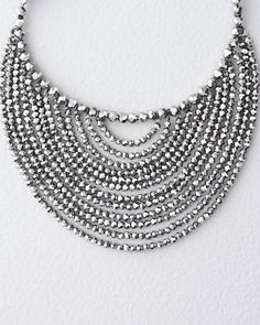 A bejeweled bib necklace has the power to transform a look — and single-handedly elevate a dress from office to evening.