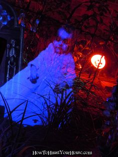 Pepper's Ghost in the cemetery. Printed image reflected into Plexiglass.