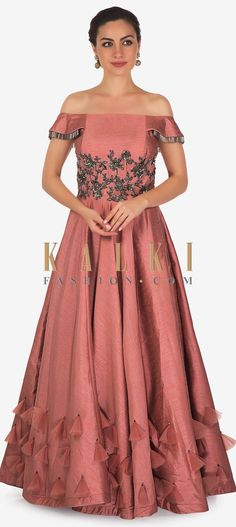 50b0dc3b Rouge pink gown featuring in raw silk. Bodice is embellished in sequin and  cut dana embroidery along with fancy tassel at sleeve.